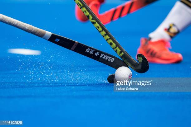Players challenge for the ball during the Women's FIH Field Hockey Pro League match between Germany and USA at Hockeypark on April 30, 2019 in...