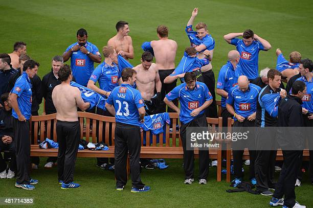 Players change shirts during a Sussex CCC photocall at the County Ground on March 31, 2014 in Hove, England.