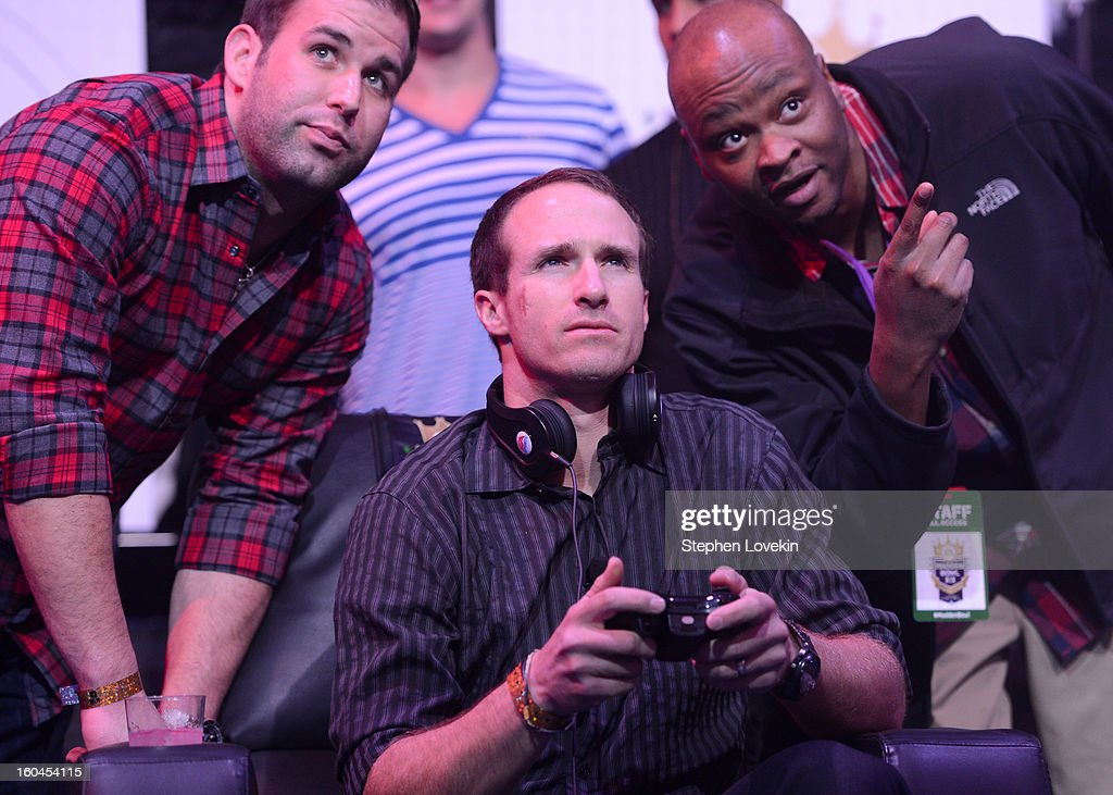 NFL players Chase Daniel (L) and Drew Brees (C) of the New Orleans Saints attend EA SPORTS Madden Bowl XIX at the Bud Light Hotel on January 31, 2013 in New Orleans, Louisiana.