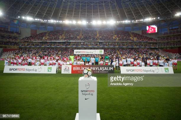 Players children with autism and referees line up for a ceremony ahead of the Turkish Super Lig match between Antalyaspor and Medipol Basaksehir at...