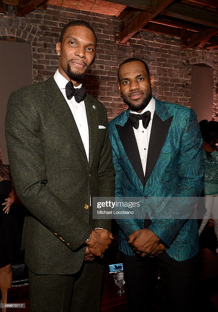 Players Chris Bosh (L) and LeBron James attend GQ & LeBron James NBA All Star Party Sponsored By Samsung Galaxy And Beats at Ogden Museum's Patrick F. Taylor Library on February 15, 2014 in New Orleans, Louisiana.