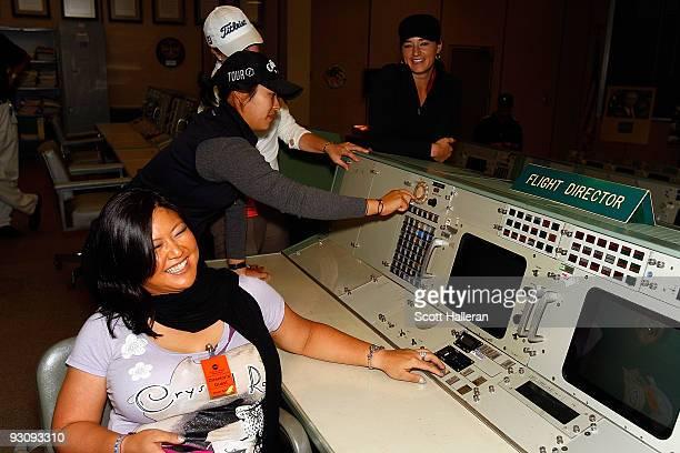 LPGA players Christina Kim Mindy Kim Leah Wigger and Brandi Jackson pose inside the Apollo control room during a visit to the Johnson Space Center to...