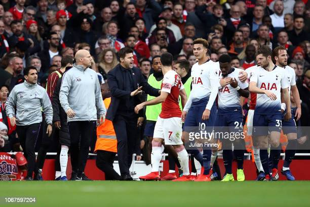 Players clash after Tottenham Hotspur's first goal during the Premier League match between Arsenal FC and Tottenham Hotspur at Emirates Stadium on...