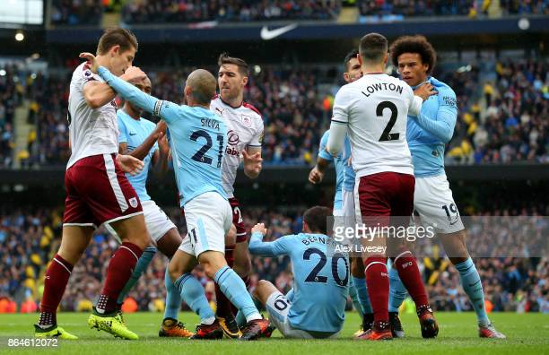 Players clash as Bernardo Silva of Manchester City is fouled for a penalty during the Premier League match between Manchester City and Burnley at...