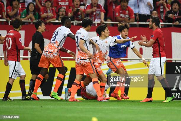 Players clash during the AFC Champions League Round of 16 match between Urawa Red Diamonds and Jeju United FC at Saitama Stadium on May 31 2017 in...