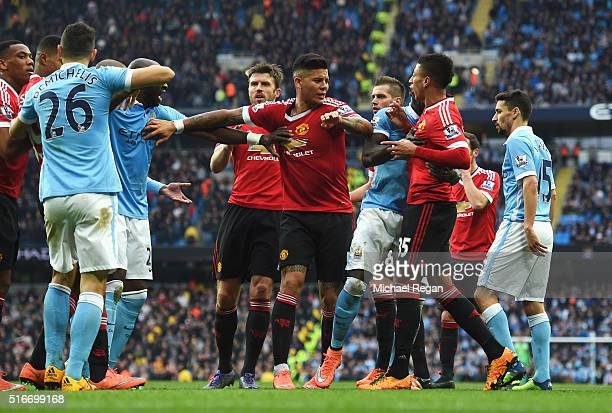 Players clash during the Barclays Premier League match between Manchester City and Manchester United at Etihad Stadium on March 20 2016 in Manchester...