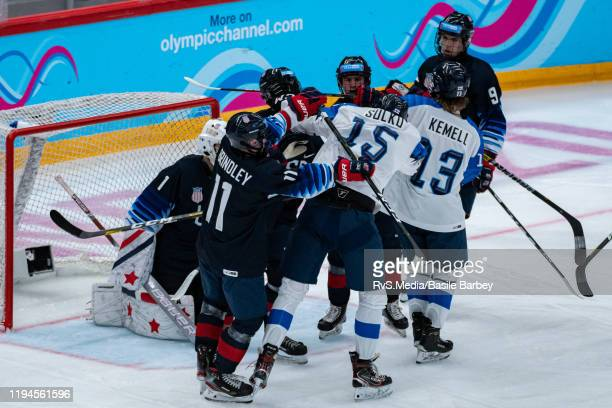Players clash in front of Goalkeeper Dylan Silverstein of United States during Men's 6Team Tournament Preliminary Round Group A Game between United...