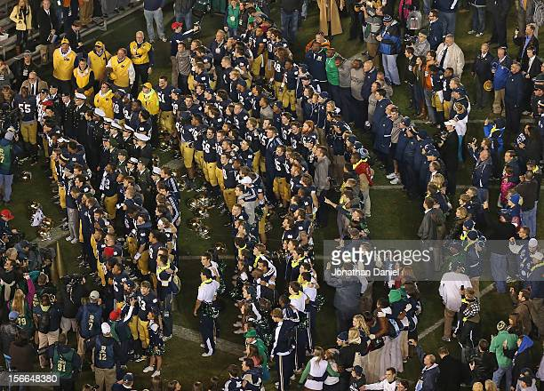 Players coaches cheerleaders and students for the Notre Dame Fighting Irish sing at alma mater following a win over the Wake Forest Demon Deacons at...