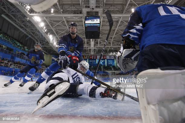 Players collide near the net in the women's preliminary round ice hockey match between Finland and the US during the Pyeongchang 2018 Winter Olympic...