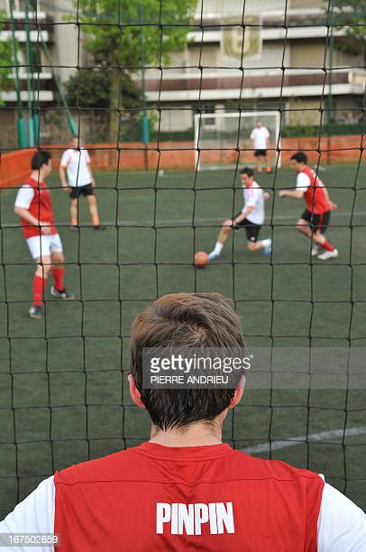 Players compete during a fiveaside football match on April 24 2013 in Puteaux outside Paris AFP PHOTO PIERRE ANDRIEU