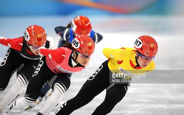 Players compete during a short track speed skating test event for the 2022 Beijing Winter Olympic Games at the Capital Indoor Stadium in Beijing on...