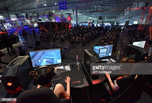 Players compete during an eSports event at Tokyo Game Show in Chiba City, suburban Tokyo on September 21, 2017. Top eSports players traded digital...