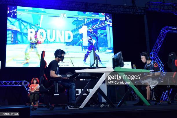 Players compete during an eSports game event at the Tokyo Game Show in Chiba on September 21, 2017. Top eSports players traded digital blows at a...