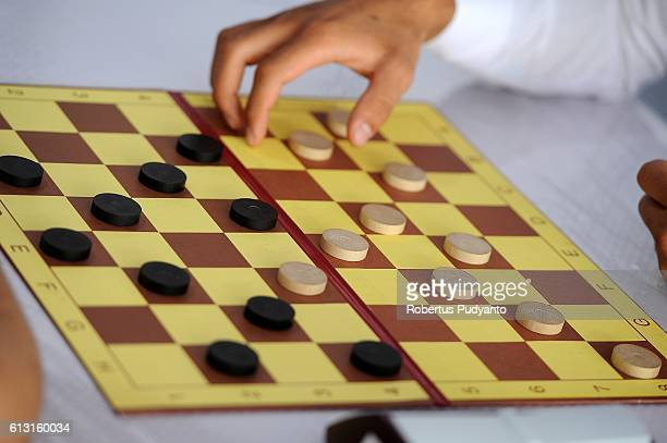 Players compete during Draughts competition of the 2016 World Tafisa Games at Taman Impian Jaya Ancol on October 7 2016 in Jakarta Indonesia