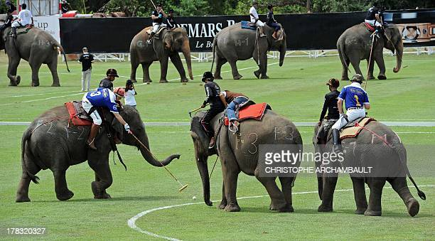 Players compete during the annual elephant polo tournament in the seaside resort of Hua Hin south of Bangkok on August 29 2013 Around a dozen teams...