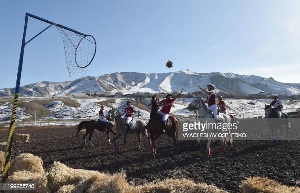 Players compete during the horseball match between Canada and France organized by the Embassy of France in Kyrgyzstan in the village of KokJar...