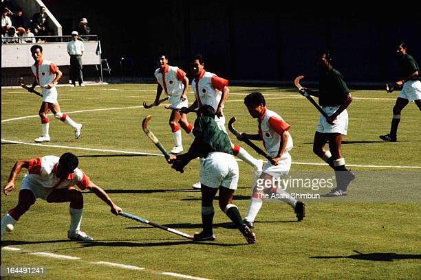 Players compete during the Men's Hockey Group A match between Japan and Pakistan during Tokyo Olympic at Komazawa Stadium on October 11 1964 in Tokyo...