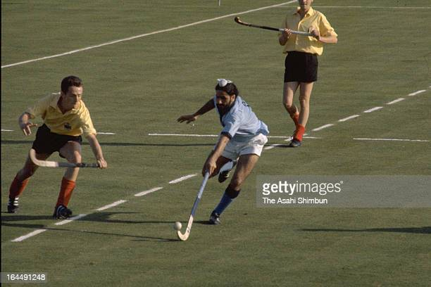 Players compete during the Men's Hockey Group B match between India and Belgium during Tokyo Olympic at Komazawa Stadium on October 11 1964 in Tokyo...