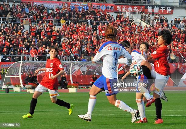 Players compete during the Nadeshiko League match between Urawa Red Diamonds Ladies and Albirex Niigata Ladies at Urawa Komaba Stadium on November...