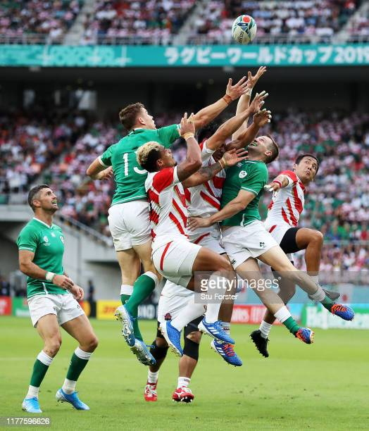 Players compete for a high ball during the Rugby World Cup 2019 Group A game between Japan and Ireland at Shizuoka Stadium Ecopa on September 28 2019...