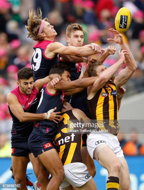 Players compete for the ball during the 2017 AFL round 07 match between the Melbourne Demons and the Hawthorn Hawks at the Melbourne Cricket Ground...