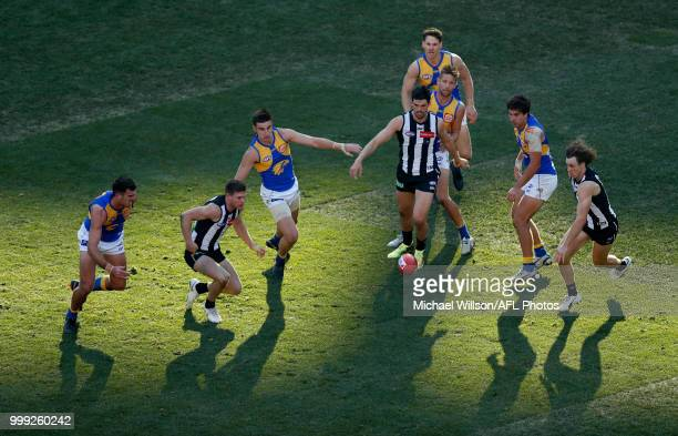 Players compete for the ball during the 2018 AFL round 17 match between the Collingwood Magpies and the West Coast Eagles at the Melbourne Cricket...