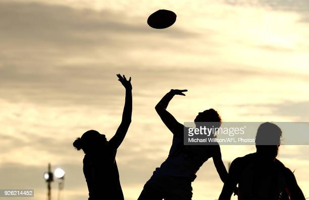 Players compete for the ball during the 2018 AFLW Round 05 match between the Melbourne Demons and the Brisbane Lions at Casey Fields on March 2, 2018...