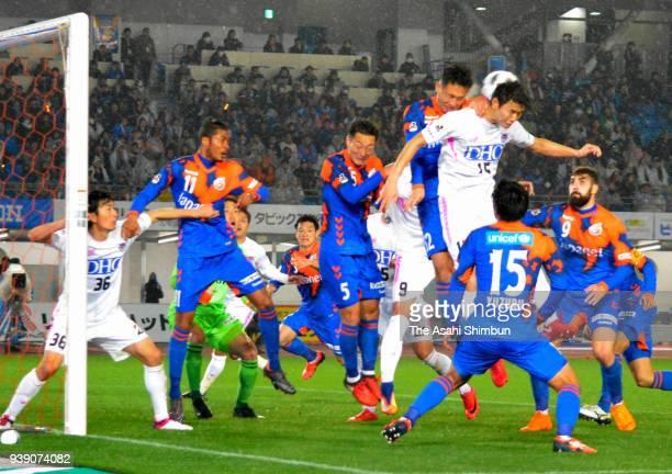 Players compete for the ball during the JLeague J1 match between VVaren Nagasaki and Sagan Tosu at Transcosmos Stadium Nagasaki on March 3 2018 in...