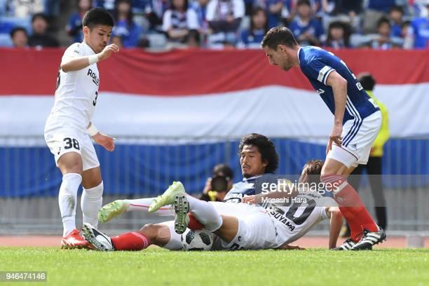 Players compete for the ball during the JLeague J1 match between Yokohama FMarinos and Vissel Kobe at Nissan Stadium on April 15 2018 in Yokohama...