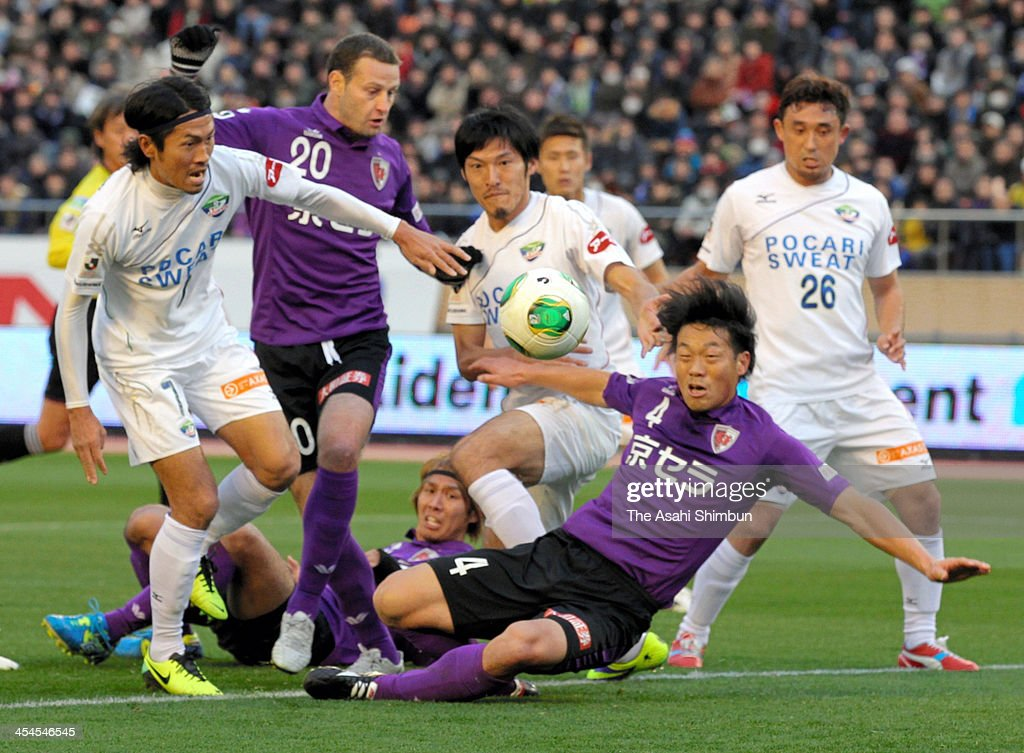 Players compete for the ball during the J.League Play-Off final match between Kyoto Sanga and Tokushima Voltis at the National Stadium on December 8, 2013 in Tokyo, Japan.