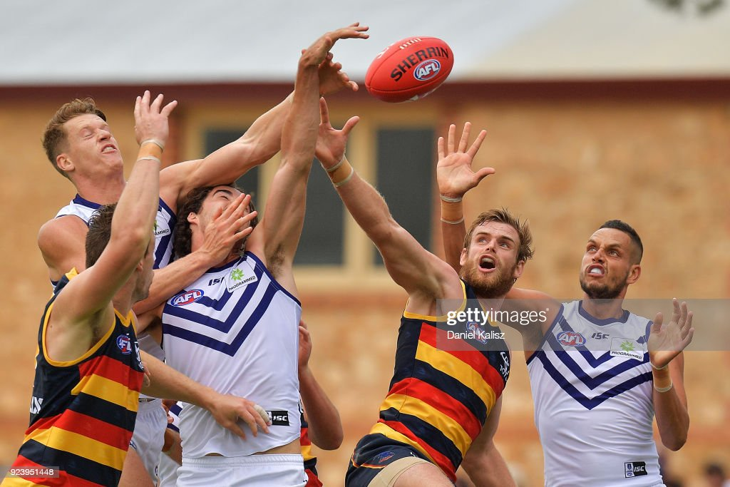 Players compete for the ball during the JLT Community Series AFL match between the Adelaide Crows and the Fremantle Dockers at Strathalbyn Oval on February 25, 2018 in Adelaide, Australia.