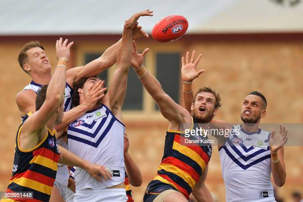 Players compete for the ball during the JLT Community Series AFL match between the Adelaide Crows and the Fremantle Dockers at Strathalbyn Oval on...