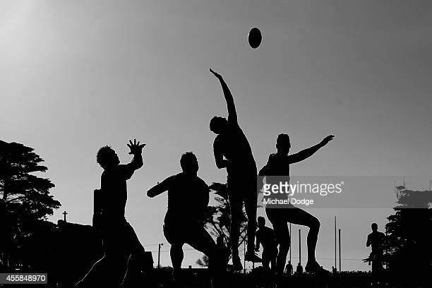 Players compete for the ball during the Peninsula Football Netball League Grand Final match between the Mornington Bulldogs and the Frankston YCW at...