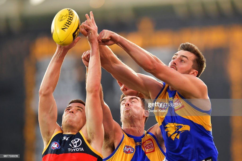 Players compete for the ball during the round 15 AFL match between the Adelaide Crows and the West Coast Eagles at Adelaide Oval on June 30, 2018 in Adelaide, Australia.