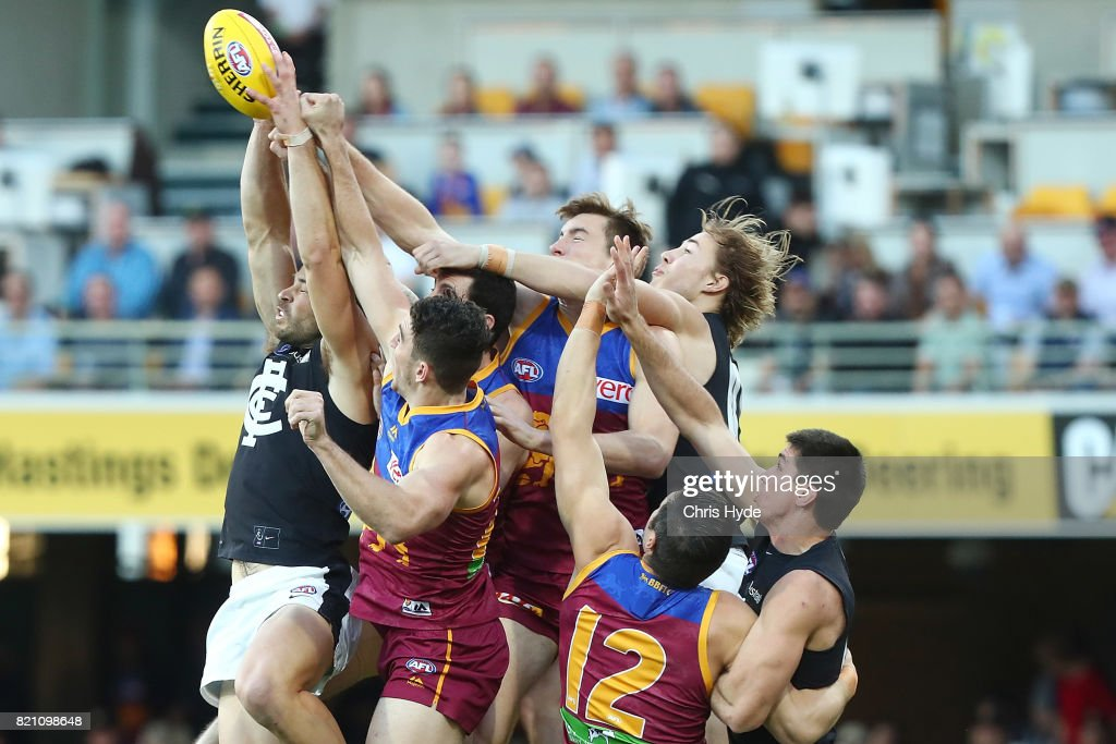 Players compete for the ball during the round 18 AFL match between the Brisbane Lions and the Carlton Blues at The Gabba on July 23, 2017 in Brisbane, Australia.