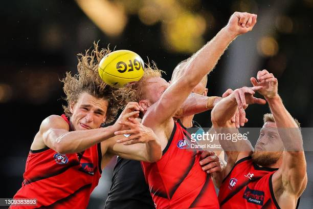 Players compete for the ball during the round 2 AFL match between Port Adelaide and the Essendon Bombers at Adelaide Oval on March 27, 2021 in...