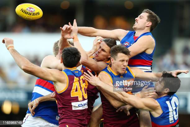 Players compete for the ball during the round 20 AFL match between the Brisbane Lions and the Western Bulldogs at The Gabba on August 04, 2019 in...