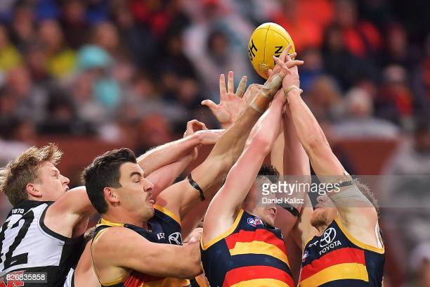 Players compete for the ball during the round 20 AFL match between the Adelaide Crows and the Port Adelaide Power at Adelaide Oval on August 6 2017...