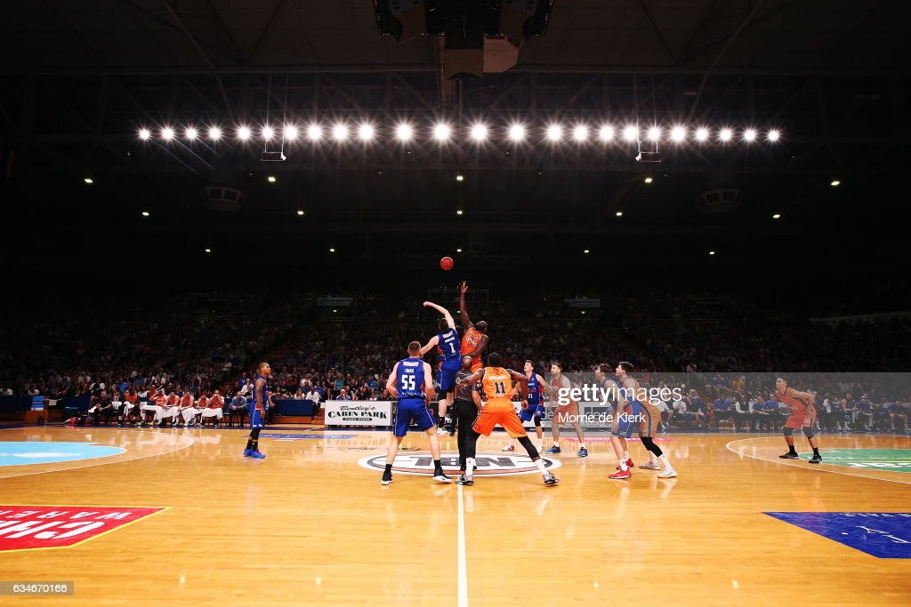 Players compete for the ball during the tip-off during the round 19 NBL match between the Adelaide 36ers and the Cairns Taipans at Titanium Security Arena on February 11, 2017 in Adelaide, Australia.
