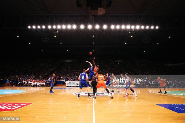Players compete for the ball during the tipoff during the round 19 NBL match between the Adelaide 36ers and the Cairns Taipans at Titanium Security...