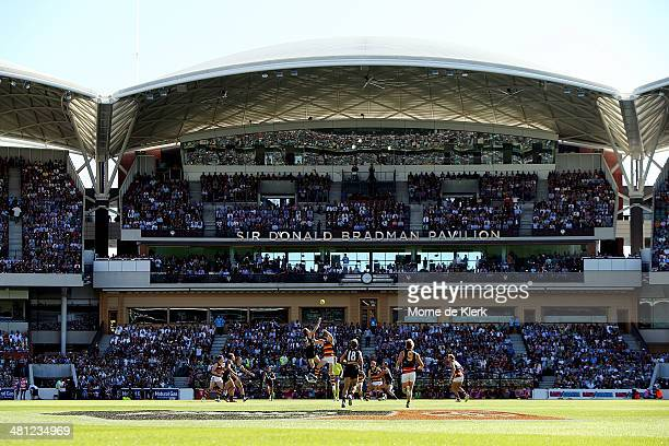 Players compete for the first bounce during the round two AFL match between the Port Adelaide Power and the Adelaide Crows at Adelaide Oval on March...