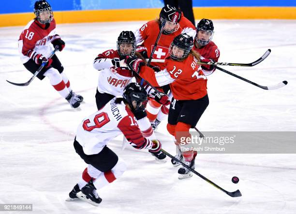 Players compete for the pack during the Women's Ice Hockey Classification game on day eleven of the PyeongChang 2018 Winter Olympic Games between...