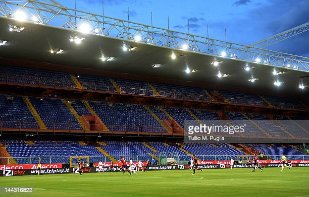 Players compete in front of empty stands during the Serie A match between Genoa CFC and US Citta di Palermo at Stadio Luigi Ferraris on May 13 2012...