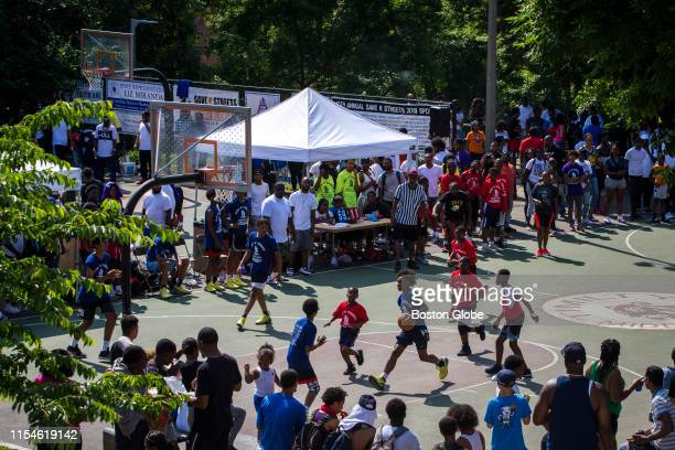 """Players compete in the 13 and under bracket of the 10th annual Save """"R"""" Streets Summer Classic basketball tournament at Jeep Jones Park in the..."""
