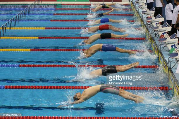 Players compete in the Men's 50m Individual Backstroke during day Two of the FINA Swimming World Cup Doha at Hamad Aquatic Centre on October 22, 2021...