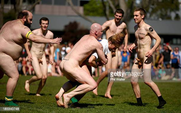Players compete in the Nude Blacks v Australia Invitational rugby match at Alhambra Union Rugby Ground on October 19 2013 in Dunedin New Zealand