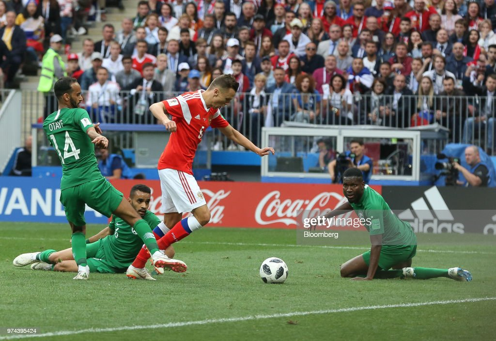 Players compete in the opening match of the FIFA World Cup between Russia and Saudi Arabia at the Luzhniki stadium in Moscow, Russia, on Thursday, June 14, 2018. President Vladimir Putin has spent six years and more than $11 billion preparing nearly a dozen Russian cities to host the soccer World Cup, the biggest such event the countrys held since the collapse of the Soviet Union. Photographer: Andrey Rudakov/Bloomberg via Getty Images