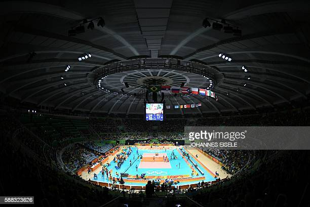TOPSHOT Players compete in the women's qualifying volleyball match between Brazil and Japan at the Maracanazinho stadium in Rio de Janeiro on August...