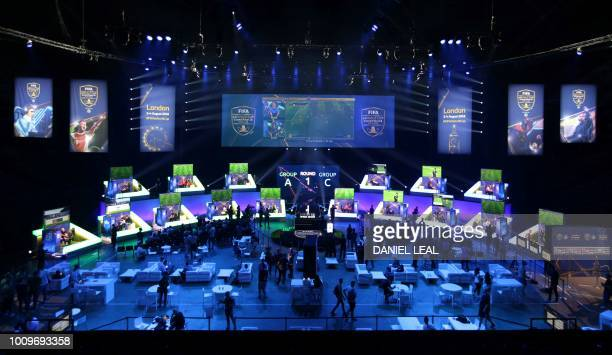 Players compete on Microsoft Xbox and Sony Playstation games consoles in the group stages of the FIFA eWorld Cup Grand Final, at the O2 in London on...
