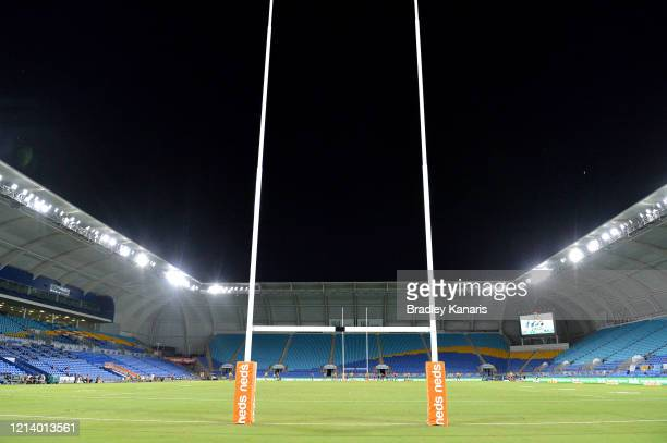 Players compete to an empty stadium due to the COVID-19 Coronavirus outbreak during the round 2 NRL match between the Gold Coast Titans and the...